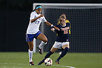 26 September 2013: Duke's Kim DeCesare (19) and Virginia's Emily Sonnett (16). The Duke University Blue Devils hosted the University of Virginia Cavaliers at Koskinen Stadium in Durham, NC in a 2013 NCAA Division I Women's Soccer match. Virginia won the game 3-2.