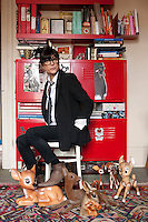 Portrait of designer Bambi Sloan surrounded by her collection of fauns