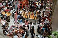 "Shoppers buy clothes and other items at a the Jusco department store in the Teem plaza in Guangzhou China during the May Day  ""golden week"" holiday. A large domestic demand for all kinds of goods from China's emerging middle class is helping to drive China's booming economy..07 May 2005"