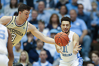 CHAPEL HILL, NC - JANUARY 4: Evan Cole #3 of Georgia Tech intercepts a pass meant for Shea Rush #11 of the University of North Carolina during a game between Georgia Tech and North Carolina at Dean E. Smith Center on January 4, 2020 in Chapel Hill, North Carolina.