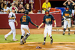 Maryland catcher Kevin Martir (32) congratulates Maryland shortstop Blake Schmit (1) after Schmit scored in the sixth inning of the game between the South Carolina Gamecocks and the Maryland Terrapins.