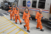 Kennedy Space Center, FL - August 8, 2007 -- The STS-118 crew waves to spectators as they head for the Astrovan. From left are Mission Specialists Alvin Drew, Barbara R. Morgan, Dave Williams and Rick Mastracchio, Pilot Charlie Hobaugh, Mission Specialist Tracy Caldwell and Commander Scott Kelly. The Astrovan will take them to Launch Pad 39A for final suit preparations before climbing into Space Shuttle Endeavour for launch at 6:36 p.m. EDT. The STS-118 mission is the 22nd shuttle flight to the International Space Station. It will continue space station construction by delivering a third starboard truss segment, S5, and other payloads such as the SPACEHAB module and the external stowage platform 3. The 11-day mission may be extended to as many as 14 depending on the test of the Station-to-Shuttle Power Transfer System that will allow the docked shuttle to draw electrical power from the station and extend its visits to the orbiting lab..Credit: Kim Shiflett - NASA via CNP