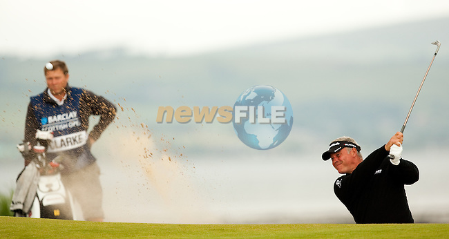 Darren Clarke blasts from a bunker during the first days play of the Barclays Scottish Open, played over the links at Castle Stuart, Inverness, Scotland from 7th to 10th July 2011:  Picture Stuart Adams /www.golffile.ie  7th July July 2011