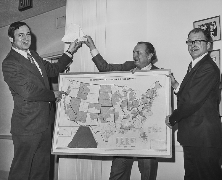 Rep. Don Young, R-Alaska., holds up map of Alaska in its proper place above the map of US in 1973. (Photo by Mickey Senko/ CQ Roll Call via Getty Images)