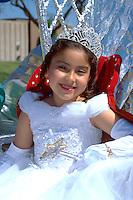 Princess riding on parade float age 5 at Cinco De Mayo Festival.  St Paul  Minnesota USA