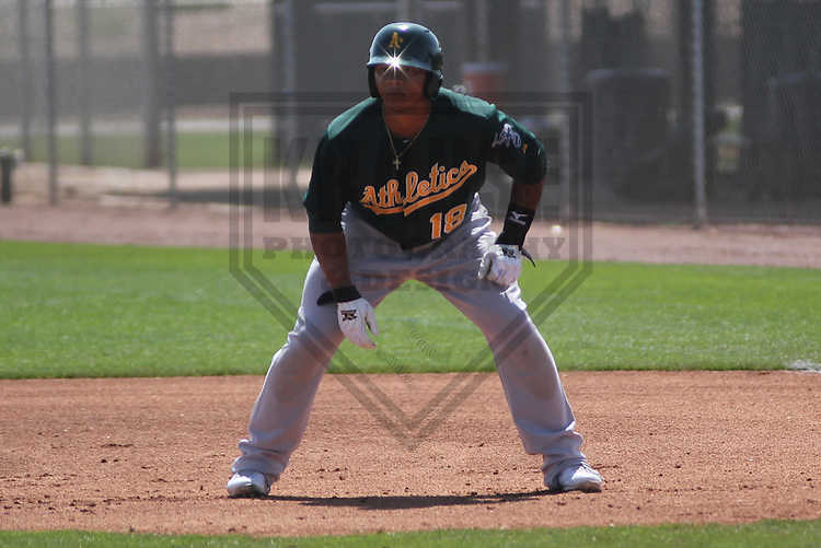 SCOTTSDALE - March 2013: Michael Choice (18)  of the Oakland A's during a Spring Training game against the Arizona DiamondBacks on March 19, 2013 at Salt River Fields in Scottsdale, Arizona.  (Photo by Brad Krause). .