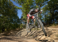 NWA Democrat-Gazette/BEN GOFF @NWABENGOFF<br /> Nathan Woodruff, owner of Progressive Trail Design based in Fayetteville, takes a test ride on Thursday Oct. 1, 2015 on the Slaughter Pen Trails downhill course in Bentonville. A crew from Progressive Trail Design are renovating the downhill course in preparation for this weekends Slaughter Pen Jam, which will feature a downhill event for the first time this year.