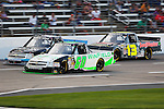 Camping World Truck Series driver Dakoda Armstron (60) and Todd Bodine (13) in action during the NCWTS Winstar World Casino 400 race at Texas Motor Speedway in Fort Worth,Texas.