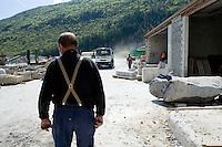 Pierre Gavazzi, stonemason (tailleur de pierre) at work at Annot quarry, Annot, France, 26 April 2010