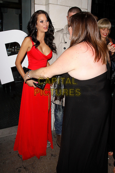 Jessica-Jane Clement &amp; Cheryl Fergison<br /> Lipsy VIP Fashion Awards 2013, DSTRKT, London, England.<br /> 29th May, 2013<br /> full length black clutch bag red dress low cut neckline cleavage back behind rear<br /> CAP/AH<br /> &copy;Adam Houghton/Capital Pictures