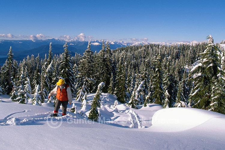 Hiker at Viewpoint on Black Mountain (1217 metres) in Winter, Cypress Provincial Park, West Vancouver, BC, British Columbia, Canada (Model Released)