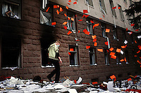 Papers fall out of the windows of the Parliament building while rioters ransack the inside in Chisinau, Moldova on 7 April 2009. Opposition leaders accused the Communists of rigging the elections on 5 April and demanded a recount. Anti-communist rotesters stormed the presidential building, demanding that President Vladimir Voronin announce his resignation and leave Moldova. More than 30 people were injured in the protests.