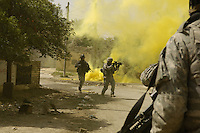Buhriz, Iraq, March 14, 2007 - U.S. Army Soldiers from the 1st Stryker Brigade Combat Team use smoke to cover their movements while engaging anti-Iraqi forces in Buhriz, Iraq, March 14, 2007. (U.S. Air Force photo by Staff Sgt. Stacy L. Pearsall) (Released)