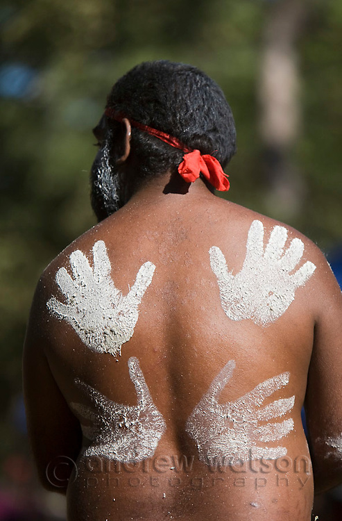 Handprint decorations on a dancer's back at the Laura Aboriginal Dance Festival.  Laura, Queensland, Australia