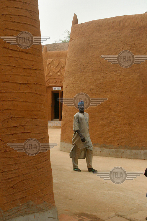 A man walks past the Kanta Museum.
