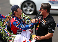 May 28, 2017; Indianapolis, IN, USA; IndyCar Series driver Takuma Sato (left) celebrates with team owner Michael Andretti after winning the 101st Running of the Indianapolis 500 at Indianapolis Motor Speedway. Mandatory Credit: Mark J. Rebilas-USA TODAY Sports