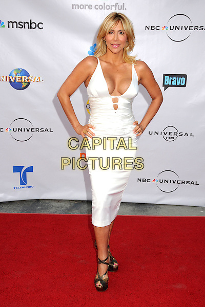 "AYLIN MUJICA.The Cable Show 2010 ""An Evening with NBC Universal"" held at Universal Studios Hollywood, Universal City, California, USA..May 12th, 2010.full length white dress low cut cleavage hands on hip.CAP/ADM/BP.©Byron Purvis/AdMedia/Capital Pictures."