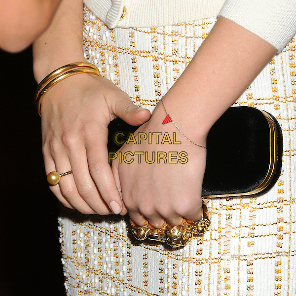 "Olivia Wilde's hands .Attending the ""Deadfall"" Los Angeles Premiere held at Arclight Cinemas, Hollywood, California, USA, .29th November 2012..detail  gold ring rings jewellery black clutch bag knuckleduster handle clasp pearl ring red triangle bracelet jewelry  .CAP/ADM/BP.©Byron Purvis/AdMedia/Capital Pictures."