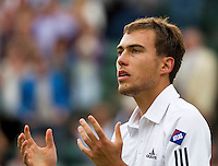 03-07-13, England, London,  AELTC, Wimbledon, Tennis, Wimbledon 2013, Day nine, Jerzy Janowicz (POL) wins his match against Lukasz Kubot (POL) and celebrates<br /> <br /> <br /> <br /> Photo: Henk Koster