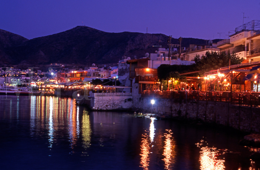 Greece. Crete. Hersonisos harbour. Waterfront Restaurants and Tavernas at night