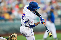 Florida Gators shortstop Richie Martin (12) swings the bat against the Miami Hurricanes in the NCAA College World Series on June 13, 2015 at TD Ameritrade Park in Omaha, Nebraska. Florida defeated Miami 15-3. (Andrew Woolley/Four Seam Images)