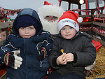 Cillian Butler and Shane Hughes pictured with santa when he visited Julianstown Community Gardens. Photo:Colin Bell/pressphotos.ie