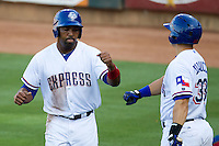 Round Rock Express outfielder Joey Butler #16 after scoring a run during the Pacific Coast League baseball game against the Albuquerque Isotopes on June 2, 2012 at the Dell Diamond in Round Rock, Texas. The Express beat the Isotopes 3-2. (Andrew Woolley/Four Seam Images).