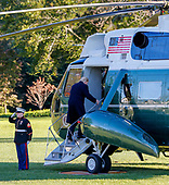 US President Donald J. Trump (R) boards Marine One before departing the White House in Washington, DC, USA, 24 October 2018. Trump was headed to Wisconsin for a campaign rally.<br /> Credit: Erik S. Lesser / Pool via CNP
