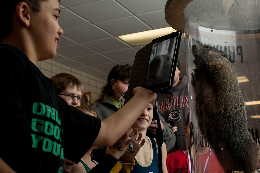 Kids visit with Punxsutawney Phil in the hall during a youth wrestling match on Saturday, January 26, 2014, when the Inner Circle brought Phil for a visit to adoring kids.