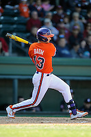 Left fielder Jay Baum (13) of the Clemson Tigers gets a hit in the Reedy River Rivalry game against the South Carolina Gamecocks on March 1, 2014, at Fluor Field at the West End in Greenville, South Carolina. South Carolina won, 10-2. (Tom Priddy/Four Seam Images)
