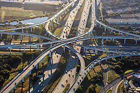 A morning aerial view from a helicopter during rush-hour of a stack spaghetti highway interchange of Mopac Expressway Loop 1 and Highway 183 in north Austin, Texas.