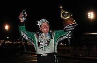 Nov 14, 2010; Pomona, CA, USA; NHRA funny car driver John Force celebrates after winning the Auto Club Finals at Auto Club Raceway at Pomona. Mandatory Credit: Mark J. Rebilas-