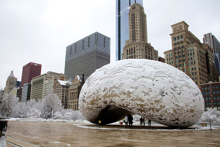 "Cloud Gate, affectionately nicknamed ""the bean"" by locals, tries to shed a blanket of snow in Chicago's Millennium Park as the harsh winter of 2014 keeps its grip on the city for a few more days, March 12, 2014. (DePaul University/Jeff Carrion)"