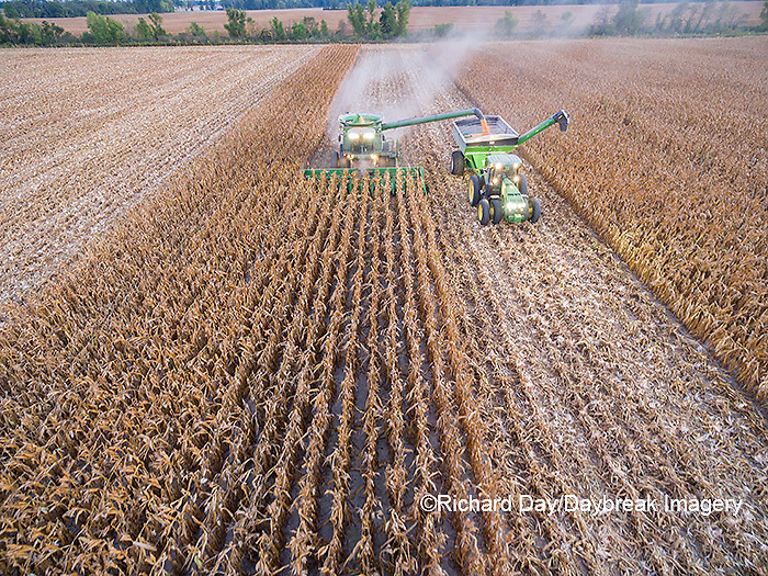 63801-08305 Corn Harvest, John Deere combine unloading corn into grain cart while harvesting - aerial Marion Co. IL