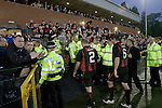 The New Saints 4 Bohemians 0, 20/07/2010. Park Hall Stadium, Champions League 2nd qualifying round 2nd leg. Supporters of Irish club Bohemians applaud their team off the field at Park Hall Stadium, Oswestry at the end of their team's Champions League 2nd qualifying round 2nd leg game away to The New Saints. Despite leading 1-0 from the first leg, the Dublin club went out following their 4-0 defeat by the Welsh champions. The match was the first-ever Champions League match in the UK played on an artificial pitch and was staged at the Welsh Premier League's ground which was located over the border in England. Photo by Colin McPherson.