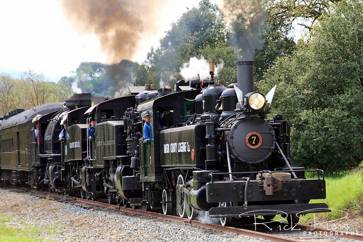 The steam locomotive Mason County Logging #7 leads a quad of steam engines towards the Hearst siding in Sunol, California, during the 2010 Niles Canyon Railway's Steamfest II.