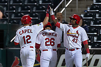 Springfield Cardinals Chris Chinea (26) and Elehuris Montero (43) congratulate Conner Capel (12) for hitting a home run during a Texas League game against the Amarillo Sod Poodles on April 25, 2019 at Hammons Field in Springfield, Missouri. Springfield defeated Amarillo 8-0. (Zachary Lucy/Four Seam Images)