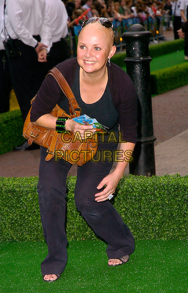 """GAIL PORTER.""""Over The Hedge"""" UK film premiere at Vue West End, London, UK..June 22nd, 2006.Ref: CAN.full length brown leather bag purse black trousers bending leaning.www.capitalpictures.com.sales@capitalpictures.com.©Capital Pictures"""