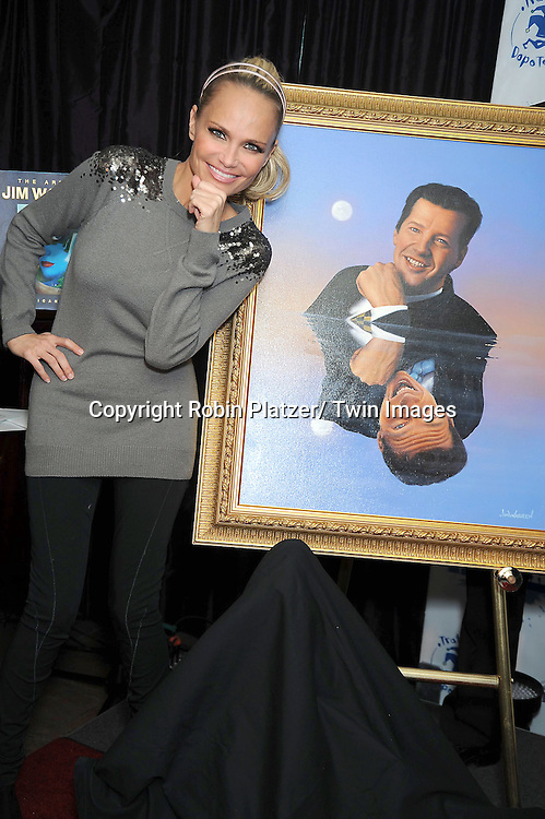 Kristin Chenoweth and Sean Hayes portrait at the unveiling of portraits of Sean Hayes and Kristin Chenoweth by Jim Warren, the artist, at Trattoria Dopo Teatro in New York City on November 21, 2010.