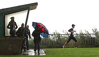 26 SEP 2010 - CLACTON, GBR - Spectators shelter from the rain as competitors make their way onto the run loop at the Clacton Standard Distance Triathlon (PHOTO (C) NIGEL FARROW)