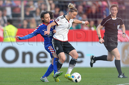12.04.2016. Osnabruck, Germany.  Germany's Alexandra Popp (R) and Croatia's Martina Salek (L) challange for the ball during the women's European Championships qualifying soccer match between Germany and Croatia in the osnatel Arena