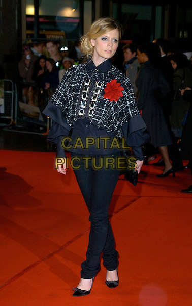 """EMILIA FOX.""""Becoming Jane"""" World Premiere, Odeon West End, .London, England, March 4th 2007..full length black coat cape red flower corsage skinny trousers Christian Louboutin shoes heels.CAP/CAN.©Can Nguyen/Capital Pictures"""