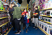 Pictured: Cameron Carter-Vickers, Nathan Dyer and Tom Carroll of Swansea City buying children gifts at Smyth's Toy Store, in Swansea, Wales, UK. Wednesday 19 December 2018