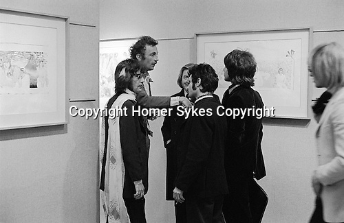 Patrick Procktor artist London 1969. April 22nd 1969 PP at opening night of his show at the Redfern Gallery, Cork Street London. L-R Ossie Clark, Patrick, ?,  man kissing hand?, Gervase Griffiths, and Peter Hinwood. <br />
