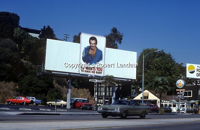 Burt Reynolds on Sunset Strip billboard for movie Paternity circa 1981
