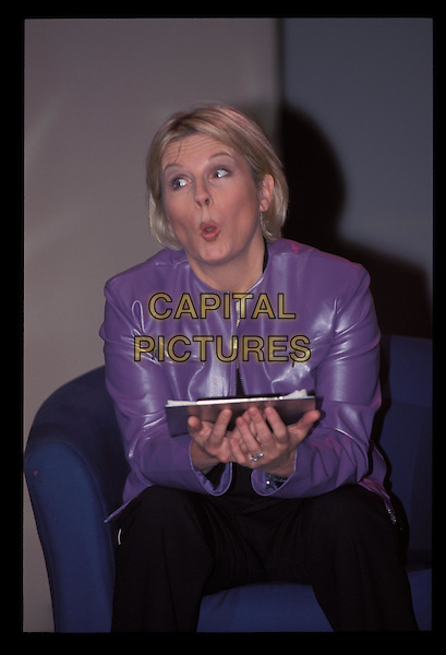 JENNIFER SAUNDERS.Ref:10160.sitting, purple leather jacket, half length, half-length.RAW SCAN - PHOTO WILL BE ADJUSTED FOR PUBLICATION.www.capitalpictures.com.sales@capitalpictures.com.©Capital Pictures.