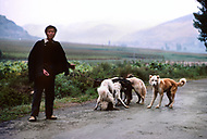 September, 1985. Shaanxi Province, China. Local farmers selling dogs to eat.