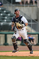 NW Arkansas Naturals catcher Micah Gibbs (27) watches a fly ball during a game against the Corpus Christi Hooks on May 26, 2014 at Arvest Ballpark in Springdale, Arkansas.  NW Arkansas defeated Corpus Christi 5-3.  (Mike Janes/Four Seam Images)
