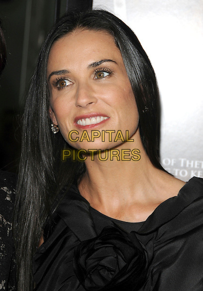 "DEMI MOORE .at The Summit Entertainment's Premiere of ""Sorority Row"" held at The Arclight Theatre in Hollywood, California, USA, September 3rd 2009                                                                   .portrait headshot black corsage diamond earrings  smiling .CAP/DVS.©DVS/RockinExposures/Capital Pictures"