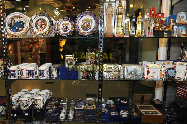 ROYAL WEDDING SOUVENIRS.on sale in tourist shops in London, England for Prince William and Catherine Middleton's wedding on 29th April 2011.Kate Middleton china marriage shelf shelves plate plate mug mugs bel bells.CAP/IA.©Ian Allis/Capital Pictures.